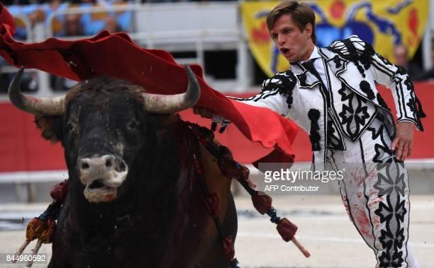 Spanish bullfighter El Juli performs a pass to Spanish Domingo Hernandez bull during a first bullfight of the Feria du Riz on September 09 2017 in...