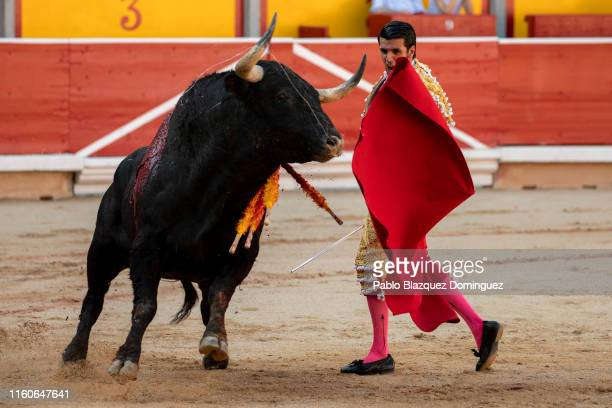 Spanish bullfighter Emilio de Justo performs with a bull from Puerto de San Lorenzo's fighting bulls during a bullfight on the second day of the San...