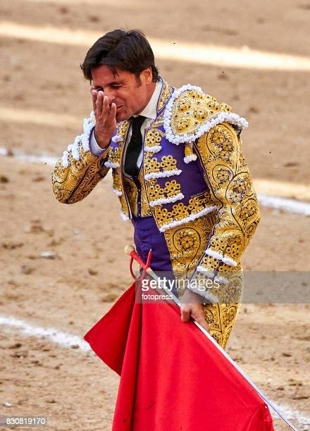 Spanish bullfighter Francisco Rivera Ordonez 'Paquirri' reacts after being a hit during a bullfighting as part of the La Peregrina Festival at Plaza...