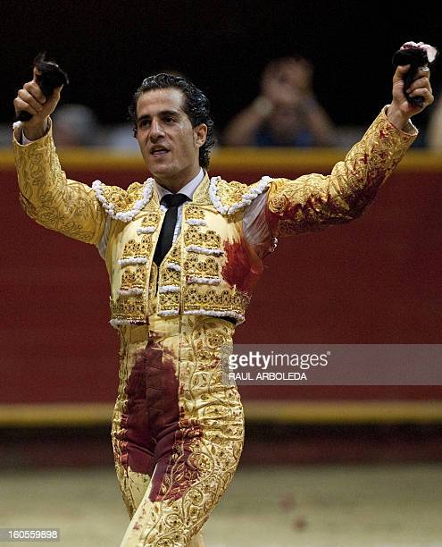 Spanish bullfighter Ivan Fandino celebrates raising the bull's ears after a bullfight at La Macarena bullring on February 2 2013 in Medellin...