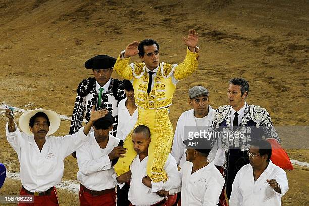 Spanish bullfighter Ivan Fandino is carried at the end of a bullfight at the Canaveralejo bullring in Cali department of Valle del Cauca Colombia on...