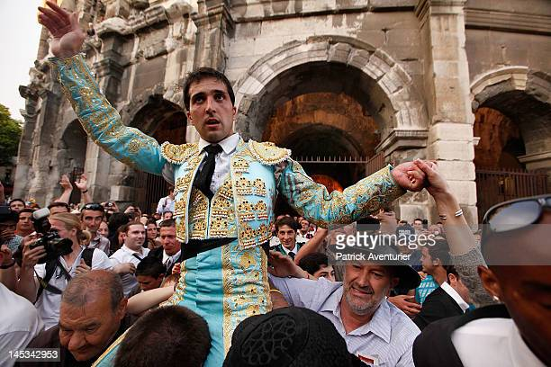 Spanish Bullfighter Javier Castano is carried from the amphitheatre by admirers following his historic solo bullfight against six Miura bulls as part...
