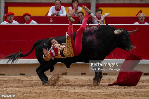 Spanish bullfighter Jose Garrido is tossed as he tried to kill a bull from Puerto de San Lorenzo's fighting bulls during a bullfight on the second...