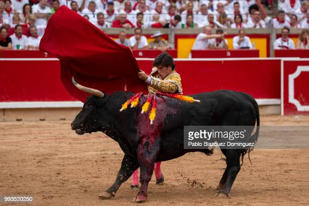Spanish bullfighter Jose Garrido performs with a bull from Puerto de San Lorenzo's fighting bulls during a bullfight on the second day of the San...
