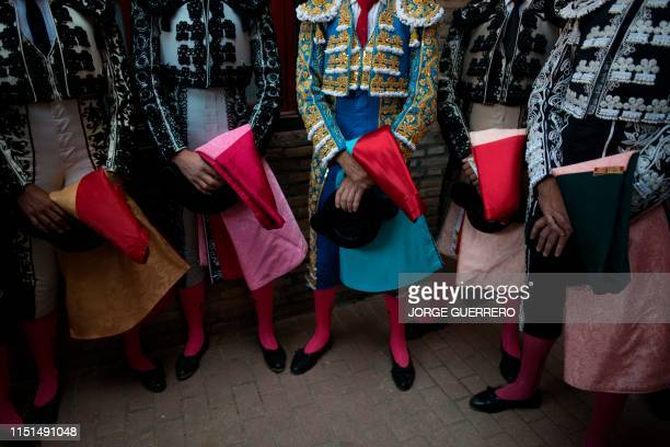 Spanish bullfighter Jose Tomas and his assistants wait prior to fighting four bulls during the Corpus bullfighting festival at the Monumental de...