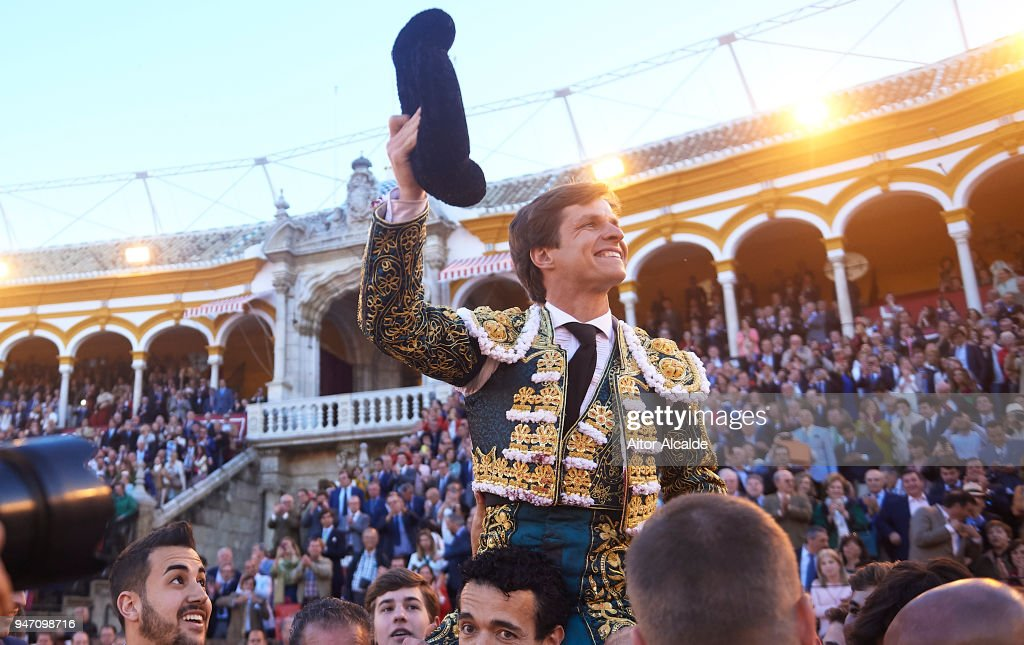 Spanish Bullfighter Julian Lopez Escobar 'El Juli' is carried by his assistants through 'La puerta grande, the big door' after the bullfight duting the Feria de Abril Bullfight at La Maestranza on April 16, 2018 in Seville, Spain.