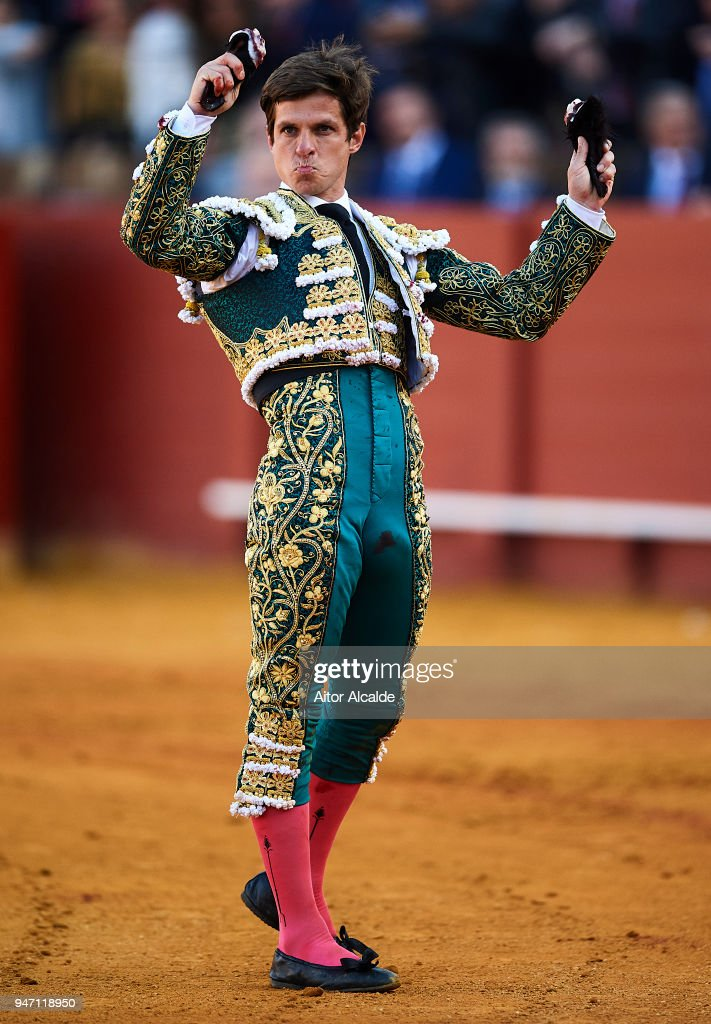 Spanish Bullfighter Julian Lopez Escobar 'El Juli' waves to the spectator after cut four ears and reprieve the last bull called 'orgullito' during the Feria de Abril Bullfight at La Maestranza on April 16, 2018 in Seville, Spain.