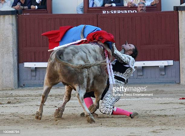 Spanish bullfighter Julio Aparicio is badly injured by a bull and is bleeding from his throat at San Isidro Fair on May 21 2010 in Madrid Spain