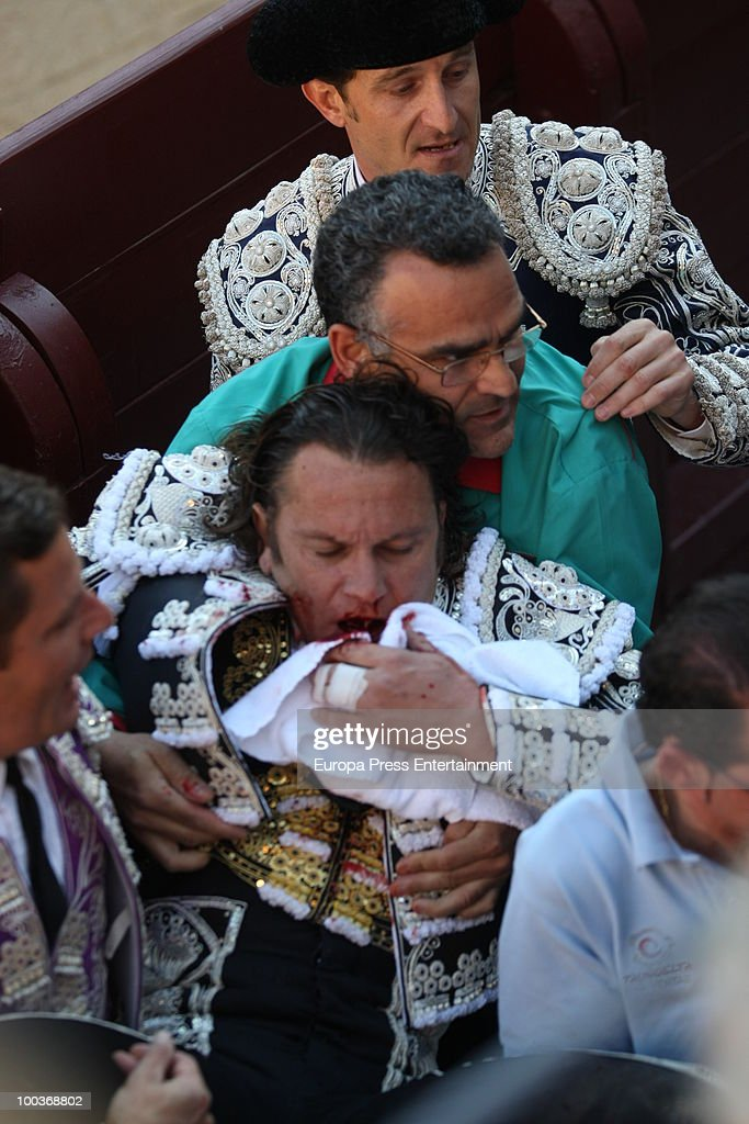 Spanish bullfighter Julio Aparicio is badly injured by a bull and is bleeding from his throat at San Isidro Fair. on May 21, 2010 in Madrid, Spain.