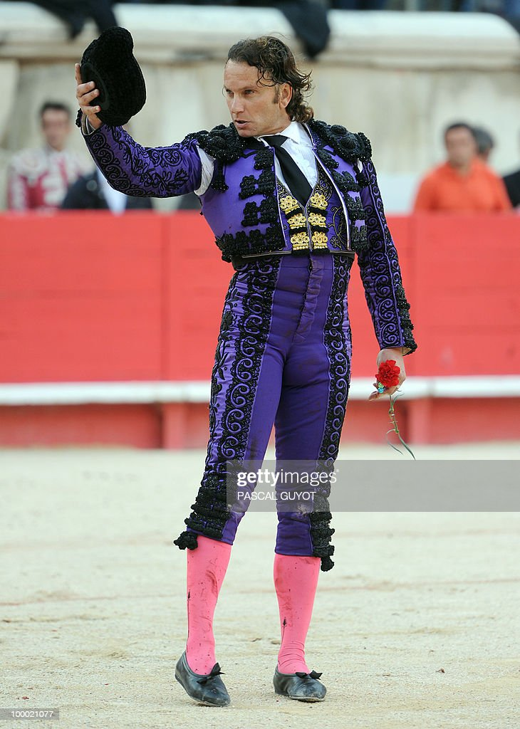 Spanish bullfighter Julio Aparicio recei