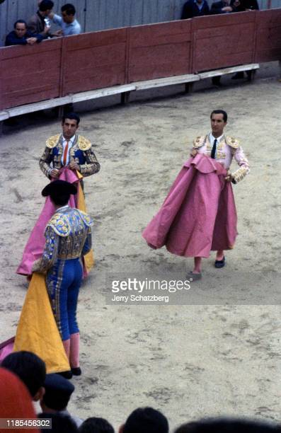 Spanish bullfighter Luis Miguel Dominguin and his brotherinlaw fellow bullfighter Antonio Ordonez Araujo carry their capotes de brega in Arles...