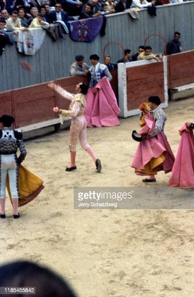Spanish bullfighter Luis Miguel Dominguin tosses an object to the crowd in Arles Amphitheater Arles France 1959
