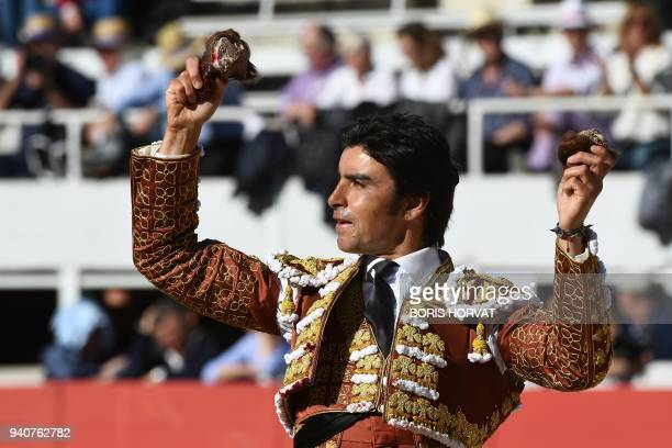 Spanish bullfighter Miguel Angel Perera shows two ears during the Feria du Riz on April 1 2018 in Arles southern France / AFP PHOTO / Boris HORVAT