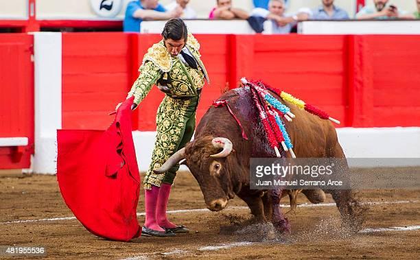 Spanish bullfighter Morante de la Puebla performs during a bullfighting as part of the Feria Santiago in a bullfight on July 25 2015 in Santander...