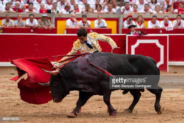 Spanish bullfighter Paco Urena performs with a bull from Puerto de San Lorenzo's fighting bulls during a bullfight on the second day of the San...