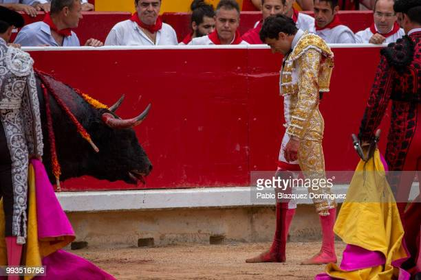 Spanish bullfighter Paco Urena wait for the death of a bull from Puerto de San Lorenzo's fighting bulls after he was gored on his leg when trying to...