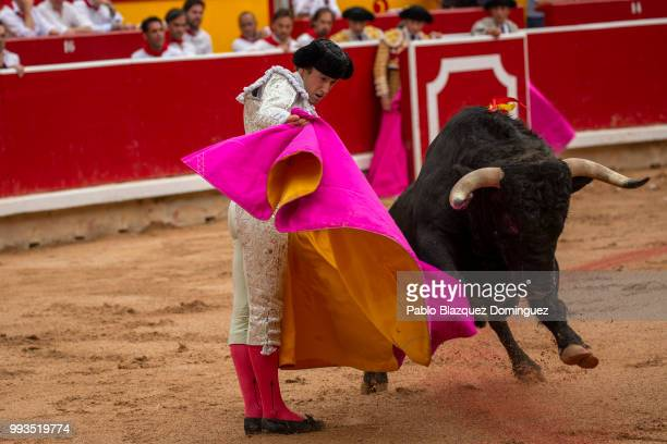 Spanish bullfighter Roman performs with a bull from Puerto de San Lorenzo's fighting bulls during a bullfight on the second day of the San Fermin...
