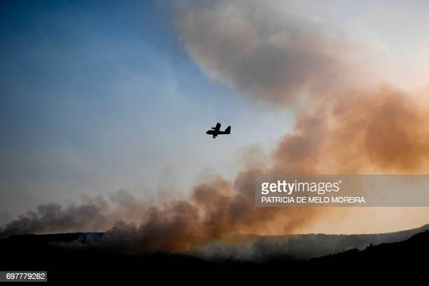 A Spanish Canadair firefighter plane combats a wildfire in Castanheira de Pera on June 19 2017 More than 1000 firefighters are still trying to...