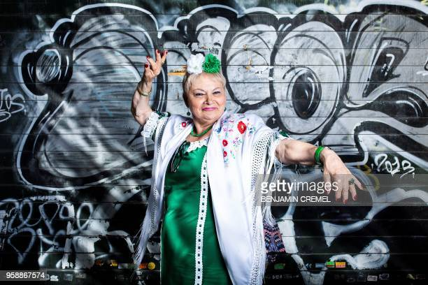 Spanish Carmen dressed in traditional chulapa garb for San Isidro celebrations poses in Madrid on May 15 2018