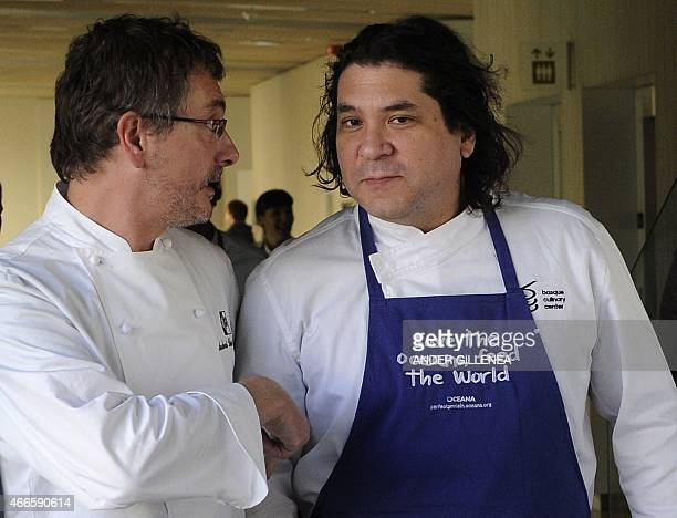 Spanish chef Andoni Luis Aduriz and Peruvian chef Gaston Acurio speak before participating in a conference supporting Oceana's worldwide campaign...