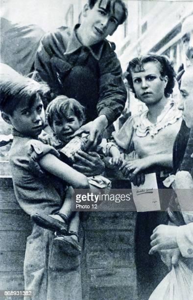 Spanish children prepare to leave Spain during the Spanish Civil War 1938.
