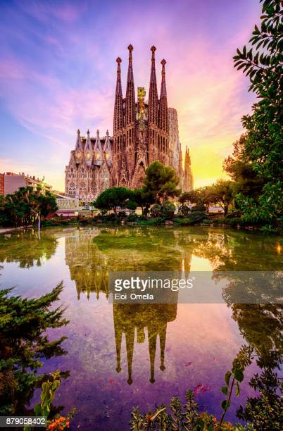 spanish cities barcelona la sagrada familia sunset clouds blue hour flare - spain stock pictures, royalty-free photos & images