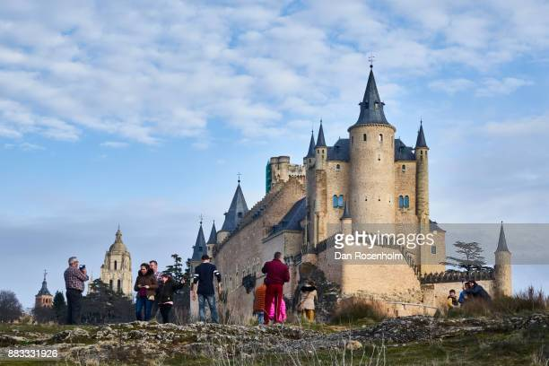 Spanish Cities, the Alcázar of Segovia with tourists taking photographs