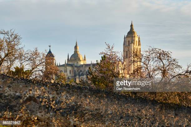 Spanish Cities, the cathedral of Segovia with a weathered stone wall in the foreground