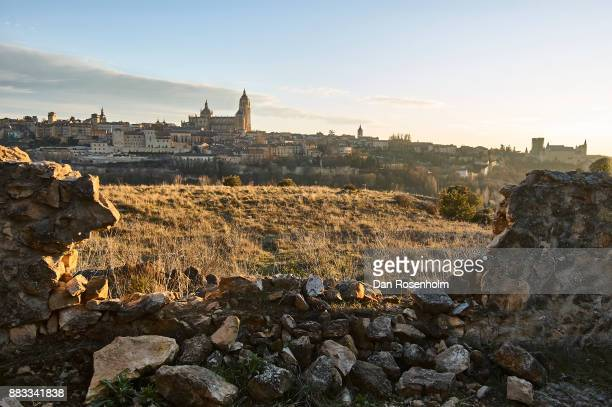 Spanish Cities, the city of Segovia with a broken stone wall in the foreground