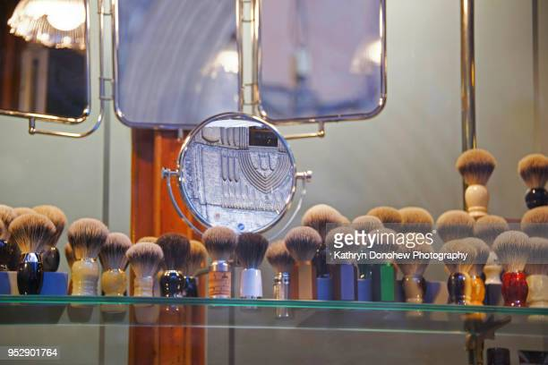 spanish cities- window display barcelona architecture - shaving brush stock photos and pictures