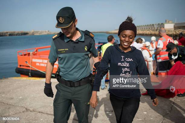 A Spanish Civil guard accompanies the only woman rescued amongst 143 Moroccans and 9 subSaharans in the waters of the Strait of Gibraltar all by the...