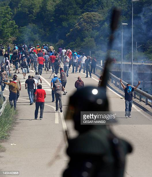 Spanish Civil Guards fire rubber bullets and tear gas to disperse demonstrating miners in Campomanes, near Oviedo in northern Spain on May 30, 2012....