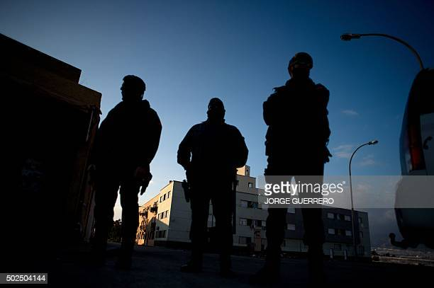 Spanish Civil Guards patrol a street on December 26 where yesterday a man from GuineaBissau was found dead in Roquetas de Mar near Almeria African...