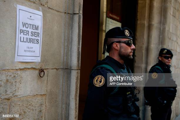 Spanish civil Guards stand guard outside the headquarters of the company of waters of Girona on September 19 2017 The Spanish Guardia Civil...