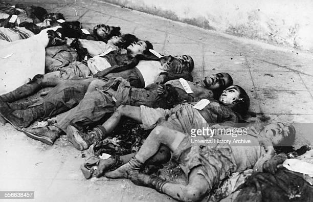 Spanish Civil War 1938 bodies of several children killed during a nationalist air raid on Barcelona