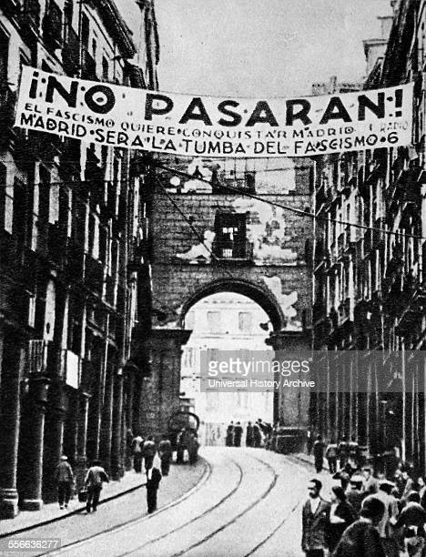 Republican banner above a Madrid street reads ' No Passaran! . Below is stated: Madrid sera la tumba del fascismo , 1937.