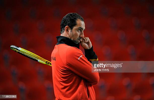 Spanish coach Albert Costa watches Davis team captain Rafael Nadal and David Ferrer on March 1 2011 during a training session in Charleroi ahead of...