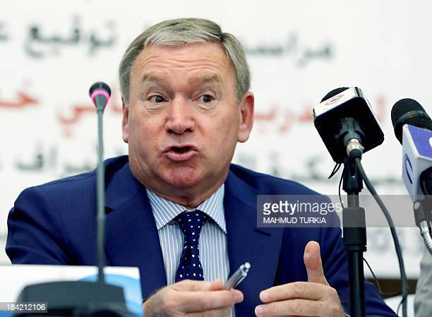 Spanish coach Javier Clemente gives a press conference as he sits next to Anwar alTechane president of the Libyan Football association after signing...