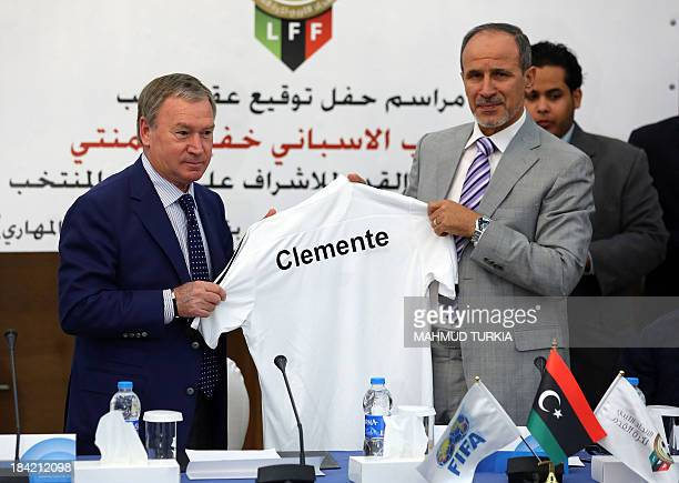 Spanish coach Javier Clemente holds up a shirt with Anwar alTechane president of the Libyan Football association after signing a contract overseeing...
