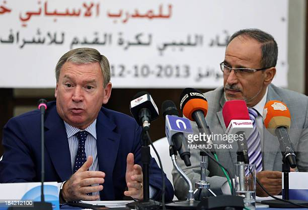 Spanish coach Javier Clemente sits next to Anwar alTechane president of the Libyan Football association after signing a contract to oversee the...