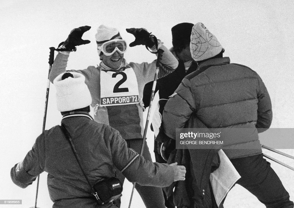 Spanish coaches run toward compatriot Francisco Fernandez Ochoa (C) to congratulate him following his victory in the men's slalom at the Winter Olympic Games 13 February 1972 in Teineyama, near Sapporo. The Spanish skier won the gold medal in front of Italians Gustavo Thoeni (silver) and his cousin Roland Thoeni (bronze). It was Spain's first ever gold medal in the Winter Olympic Games.