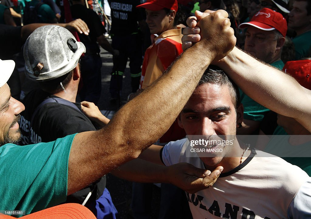 Spanish coal miner greet each other during a demonstration on july spanish coal miner greet each other duri news photo m4hsunfo