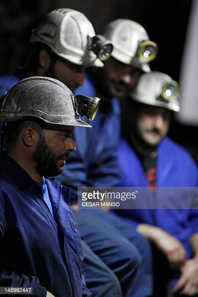 Spanish coal miners sit together as they spend their nineteenth day underground in a mine in Santa Cruz del Sil in the northern province of Leon on...