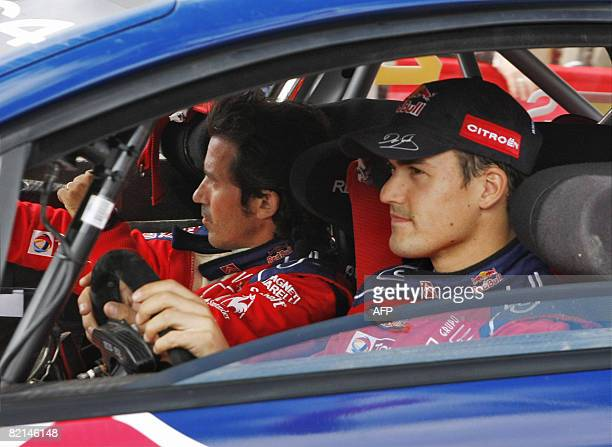 Spanish codriver Marc Marti and Citroen pilot Daniel Sordo sit in tehir car on August 1 2008 during a break in the service pits of Finland's WRC...