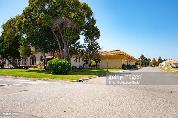 Spanish Colonial Revival style buildings with large trees within the secure area of the NASA Ames Research Center campus in the Silicon Valley town...