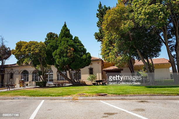 Spanish Colonial Revival style buildings with trees within the secure area of the NASA Ames Research Center campus in the Silicon Valley town of...