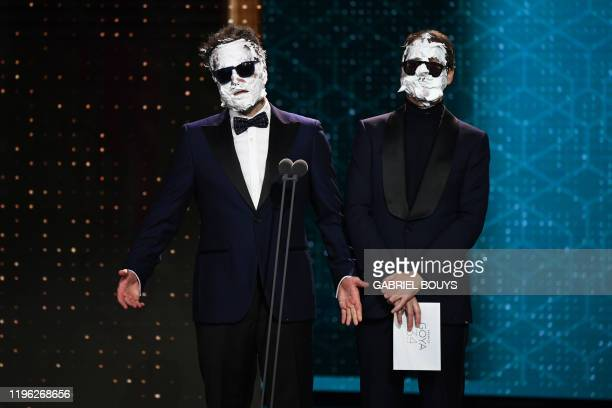 Spanish comedians Ernesto Sevilla and Joaquin Reyes present the award to the best makeup at the 34th Goya awards ceremony in Malaga on January 25 2020