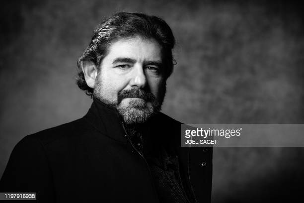Spanish comics artist Juanjo Guarnido poses on February 1, 2020 in Angouleme, western France, during the 47th Angouleme International Comics Festival...