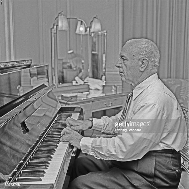 Spanish conductor and pianist José Iturbi playing an upright C. Bechstein piano, UK, 31st October 1964.