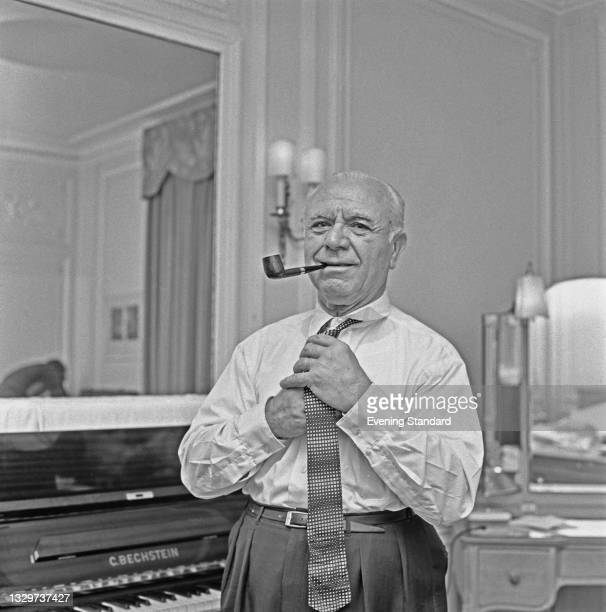 Spanish conductor and pianist José Iturbi , UK, 31st October 1964. Behind him is an upright C. Bechstein piano.
